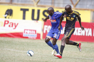 Denis Mukaisi of Posta Rangers battles for the ball with James Omino of Chemilil Sugar Photo: Nation